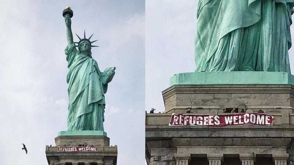 USA [photo]: une banderole « Bienvenue aux réfugiés » accrochée sur la Statue de la Liberté